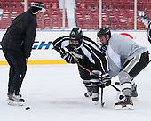 Jamie Russell (PC - Assistant Coach), Kevin Rooney (PC - 21), Mark Jankowski (PC - 10) -  - The participating teams in Hockey East's first doubleheader during Frozen Fenway practiced on January 3, 2014 at Fenway Park in Boston, Massachusetts.