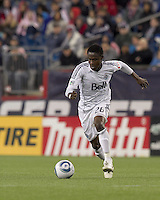 Vancouver Whitecaps FC midfielder Gershon Koffie (28) dribbles. In a Major League Soccer (MLS) match, the New England Revolution defeated the Vancouver Whitecaps FC, 1-0, at Gillette Stadium on May14, 2011.