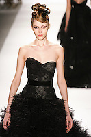Yulia Kharlapanova walks runway in a Monique Lhuillier Fall 2011 outfit, during Mercedes-Benz Fashion Week Fall 2011.