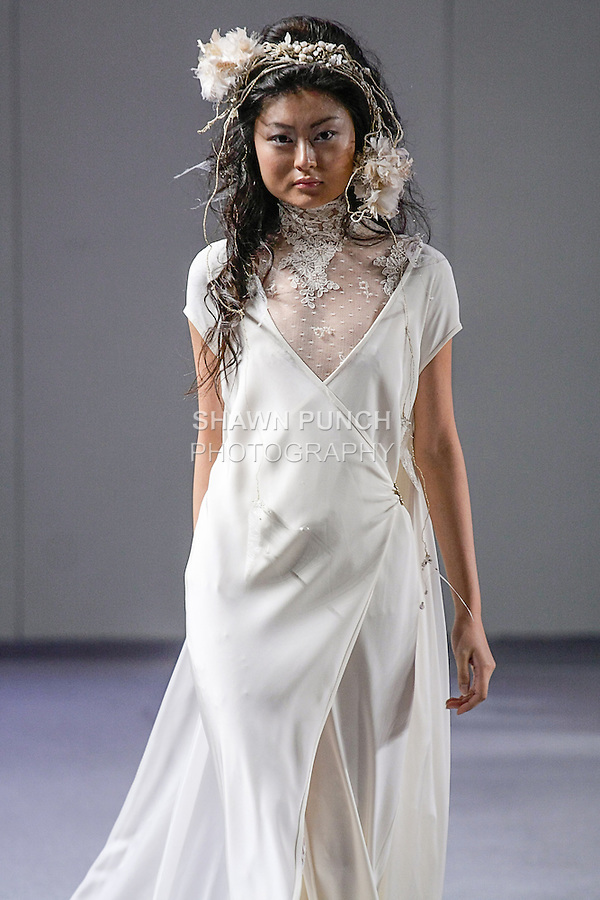 """Model walks runway in a bridal gown from Isabel Zapardiez """"Remembering"""" collection, during Couture Fashion Week in New York City, September 15, 2012."""