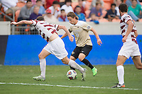 Houston, TX -  Sunday, December 11, 2016: Hayden Partain (21) of the Wake Forest Demon Deacons brings the ball up the field in the first half against the Stanford Cardinal at the  NCAA Men's Soccer Finals at BBVA Compass Stadium.