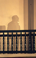 Cuban President Fidel Castro casts a distinctive shadow on a balcony in Santiago de Cuba during a 40th anniversary speech made from the same rail where he addressed crowds after winning the revolution in 1959.