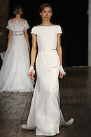 "Model walks runway in a ""Timeless"" bridal gown from the Rivini by Rita Vinieris Fall 2017 collection on October 7th, 2016 during New York Bridal Fashion Week."
