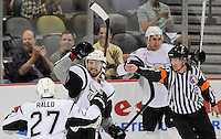 San Antonio Rampage's Colby Robak, center, celebrates with teammates Greg Rallo (27) and Jon Matsumoto as the referee calls his goal against the Milwaukee Admirals during the first period of an AHL hockey game, Tuesday, April 10, 2012, in San Antonio. (Darren Abate/pressphotointl.com)