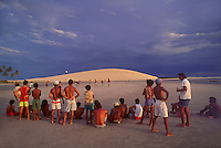 Fishermen play soccer in Jericoacoara beach, Ceara State, Brazil -daily life in a fishing touristic village.