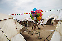 A man sells balloons to celebrate the muslim festival of Eid, in a camp for people displaced by the floods, in Sukkur, Sindh Province, Pakistan.