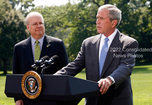 """Washington, D.C. - August 13, 2007 -- United States President George W. Bush makes remarks as he prepares to depart the White House for a vacation in Crawford, Texas after Deputy Chief of Staff Karl Rove announced on Monday, August 13, 2007 that he is leaving the Bush Administration at the end of August, 2007. Standing next to United States President George W. Bush, Rove told reporters """"I am grateful to have been a witness of history. It has been the joy and the honor of a lifetime."""" Rove, a close friend of President Bush has been his most prominent advisor and political strategist..Credit: Aude Guerrucci - Pool via CNP"""