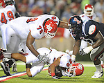 Ole Miss defensive tackle Jerrell Powe (57) gets past Fresno State offensive lineman Devan Cunningham (79) and tackles Fresno State's A.J. Ellis (23) at Vaught-Hemingway Stadium in Oxford, Miss. on Saturday, September 25, 2010. Ole Miss won 55-38 over Fresno State.