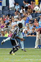 Kansas City midfielder Paulo Nagamura (6)  heads the ball... Sporting Kansas City defeated San Jose Earthquakes 2-1 at LIVESTRONG Sporting Park, Kansas City, Kansas.