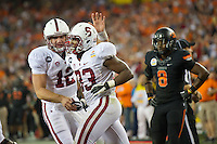 STANFORD, CA - January 2, 2012: Stanford quarterback Andrew Luck (12) congratulates running back Stepfan Taylor (33) on this touchdown against Oklahoma State at the Fiesta Bowl at University of Phoenix Stadium in Phoenix, AZ. Final score Oklahoma State wins 41-38.