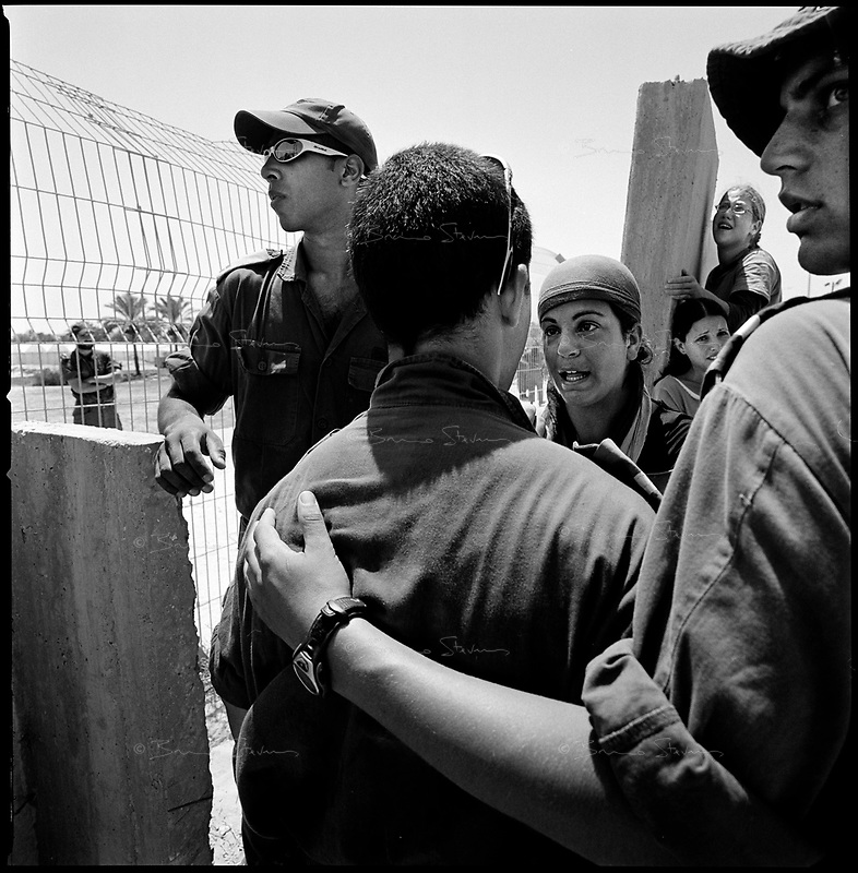 Shirat Ayam Settlement, Gaza strip Israel, Aug. 2005..Waiting for the evacuation. Young settlers trying to convince soldiers not to proceed with the evacuation, many soldiers got very emotional and even cried...