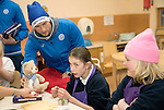 St Johnstone players took some festive cheer to Fairview School in Perth gving out selection boxes and gifts to the pupils&hellip;David Wotherspoon hands over a saints teddy bear to secondary school pupil Emily<br />Picture by Graeme Hart.<br />Copyright Perthshire Picture Agency<br />Tel: 01738 623350  Mobile: 07990 594431