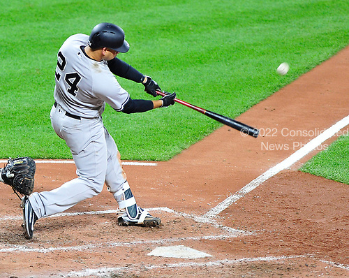 New York Yankees catcher Gary Sanchez (24) connects for a 2 run home run in the fifth inning giving his team a 5 - 1 lead against the Baltimore Orioles at Oriole Park at Camden Yards in Baltimore, MD on Friday, April 7, 2017.<br /> Credit: Ron Sachs / CNP<br /> (RESTRICTION: NO New York or New Jersey Newspapers or newspapers within a 75 mile radius of New York City)