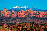Sedona and the distant snow-capped San Francisco Peaks, as seen from Perkinsville Rd - AZ
