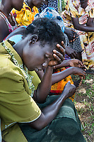 N. Uganda, Kitgum District. Namokana Outreach Center where patients come for initial PCAF psychiatric assessment. Women--wives and mothers-- meet as part of group therapy to discuss their problems and concerns. How to handle their grown children and husbands abusing drinking and drugs due to PTSD and mental distress is a major topic of discussion.