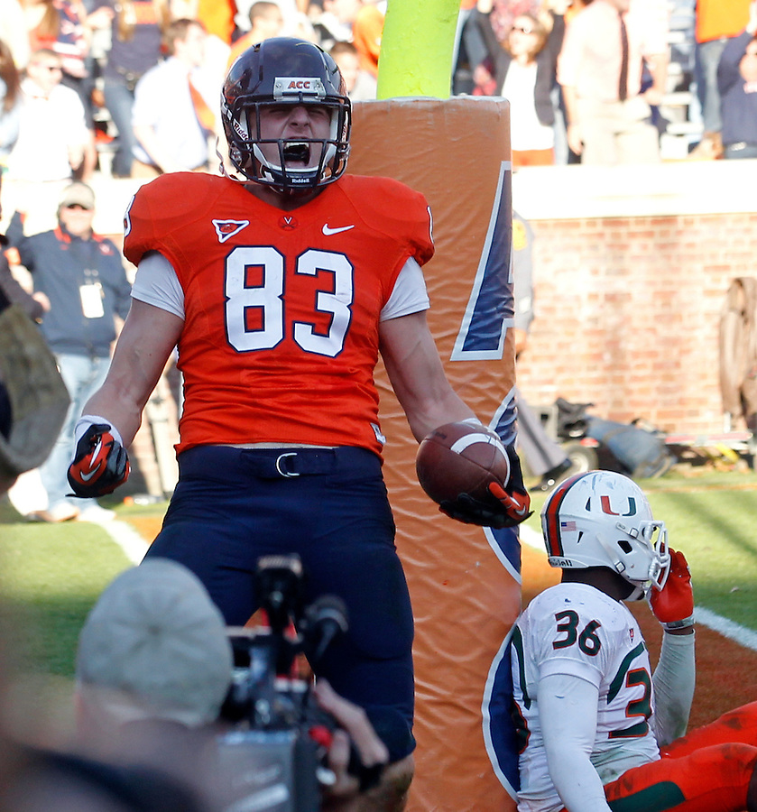 Virginia Cavaliers tight end Jake McGee (83) reacts to making the game winning catch next to Miami Hurricanes linebacker Gionni Paul (36) with 6 seconds left on the game clock in the 4th quarter of the game at Scott Stadium in Charlottesville, VA. Virginia won 41-40.