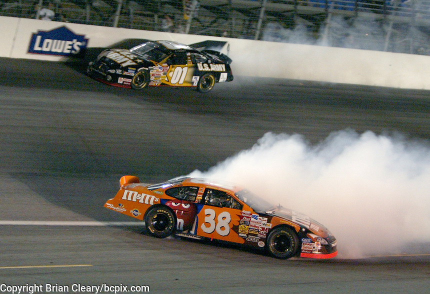 Elliott Sadler, 38, Mike Skinner, 01, crash, accident, UAW-GM Quality 500, Charlotte Motor Speedway, Charlotte, NC, October 11, 2003.  (Photo by Brian Cleary/bcpix.com)