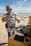 Mark Proster perparing to take swabs from cloaca and mouth of a young Peregrine Falcon during the annual Padre Island Peregrine Falcon Survey on south Padre Island, autumn