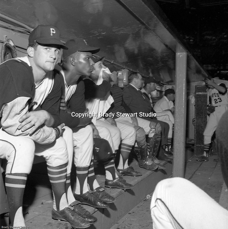 Pittsburgh PA:  Don Clendenon and Bob Priddy sitting in the dugout at the HYPO charity baseball game with the Milwaukee Braves.<br />