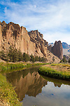 Smith Rock State Park is a state park located in central Oregon's high desert near the towns of Redmond and Terrebonne. Its sheer cliffs of tuff and basalt are ideal for rock climbing of all difficulty levels. Smith Rock is generally considered the birthplace of modern American sport climbing, and is host to cutting-edge climbing routes.  In addition to the world-famous rock climbing, Smith Rock State Park is host to many miles of hiking trails, the meandering Crooked River and views of the volcanic peaks of Oregon's Cascade Range.