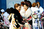 Kimono-clad 20-year-old Japanese women enjoy a beer and cigarette during an event to mark Coming-of-Age Day at Toshimaen amusement park in Tokyo, Japan on Monday Jan. 11, 2009. Japanese enter adulthood at 20, when they can legally smoke, drink alcohol and vote, though debate is heating up as to whether or not the age should be lowered to 18 in line with many advanced countries. Indeed, the Japanese government plans to lower the voting age to 18 as of mid-2010.