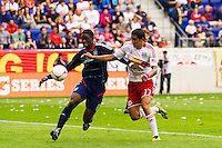 Jalil Anibaba (6) of the Chicago Fire battles for the ball with Tim Cahill (17) of the New York Red Bulls. The Chicago Fire defeated the New York Red Bulls 2-0 during a Major League Soccer (MLS) match at Red Bull Arena in Harrison, NJ, on October 06, 2012.