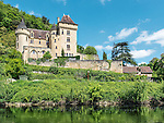 The Château de La Malartrie is a private residence located in the commune of Vézac immediately adjacent to La Roque-Gageac. Originally constructed in the 12th century, the castle was completely rebuilt in Renaissance style at the end of the 19th century. The château is here viewed from a Gabare Norbert on the Dordogne.