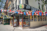 Bunting decorates the newly opened Peter Cooper Deli in the Stuyvesant Town-Peter Cooper Village neighborhood of New York on Saturday, May 14, 2016.  (© Richard B. Levine)