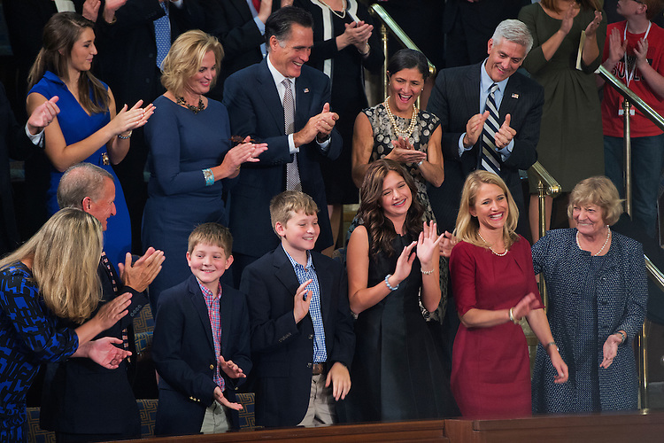 UNITED STATES - OCTOBER 29: The family of Rep. Paul Ryan, R-Wisc., is recognized before he was sworn in on the House floor as the 54th Speaker of the House, October 29, 2015.  From left, are sons Sam, Charlie, daughter Liza, and wife Janna. Mitt Romney also appears in the second row. (Photo By Tom Williams/CQ Roll Call)