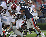 Alabama running back Trent Richardson (3) is tackled by Ole Miss' Frank Crawford (5) at Vaught-Hemingway Stadium in Oxford, Miss. on Saturday, October 14, 2011. Alabama won 52-7.