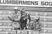Bobby Rahal (left), Brian Redman (center) and Tony Cicale (right) celebrate their victory in the 1979 Lumbermens 6 Hours race at Mid-Ohio Sports Car Course.