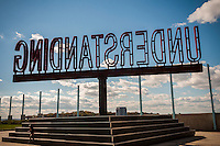 """The rotating """"Understanding"""" public art sculpture in Brooklyn Bridge Park in New York on Sunday, October 23, 2016. """"Understanding"""" by the artist Martin Creed features a 25 foot tall rotating red sculpture spelling out the word understanding reminiscent of a billboard on the side of a highway.  (© Richard B. Levine)"""