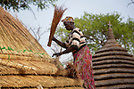 Mary Musiah constructs a thatched roof in Agok, a town in the contested Abyei region where tens of thousands of people--including Musiah--fled in 2011 after an attack by soldiers and militias from the northern Republic of Sudan on most parts of Abyei. Although the 2005 Comprehensive Peace Agreement called for residents of Abyei--which sits on the border between Sudan and South Sudan--to hold a referendum on whether they wanted to align with the north or the newly independent South Sudan, the government in Khartoum and northern-backed Misseriya nomads, excluded from voting as they only live part of the year in Abyei, blocked the vote and attacked the majority Dinka Ngok population. The African Union has proposed a new peace plan, including a referendum to be held in October 2013, but it has been rejected by the Misseriya and Khartoum. The Catholic parish of Abyei, with support from Caritas South Sudan and other international church partners, has maintained its pastoral presence among the displaced and assisted them with food, shelter, and other relief supplies.