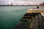 A view of Riva degli Schiavoni and San Marco basin with San Giorgio Island and downtown Venice skyline in the background. Taken on a cold and rainy evening of December, this is stitched from four vertical frames.