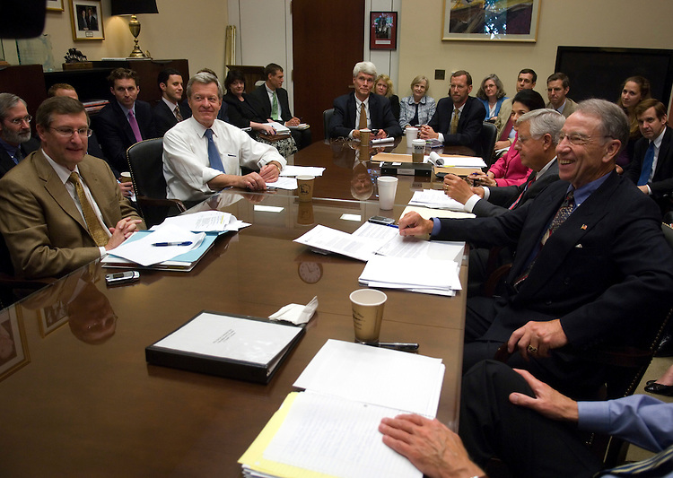 WASHINGTON, DC - July 23: Senate Finance members during a photo op of their meeting in the office of Chairman Max Baucus, D-Mont., on the panel's development of a comprehensive healthcare overhaul bill. On the left side of the table are Sen. Kent Conrad, D-N.D., and Baucus; on the right are ranking member Charles E. Grassley, R-Iowa, foreground, Sen. Michael B. Enzi, R-Wyo, and Sen. Olympia J. Snowe, R-Maine. (Photo by Scott J. Ferrell/Congressional Quarterly)