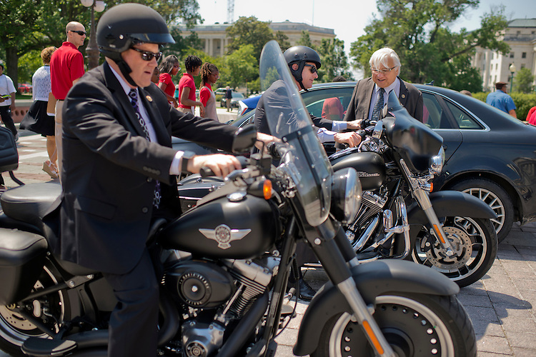 UNITED STATES - MAY 26: Rep. Mike Honda, D-Calif., checks out the Harley-Davidson motorcycles of Reps. Reid Ribble, R-Wis., left, and Scott Rigell, R-Va., on the East Front of the Capitol after the last votes in the House which begins the Memorial Day recess, May 26, 2016. (Photo By Tom Williams/CQ Roll Call)