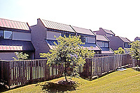 Moshe Safdie Assoc. : Coldspring New Town Apartments. Balconies ringing interior open space. Photo '85.