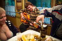 The medical team on board the Matvei Mudrov train celebrates Maslenitsa in the train&rsquo;s dining car, drinking vodka and playing music. Maslenitsa is an eastern Slavic festival which is celebrated to mark the imminent end of winter. <br /> <br /> The Matvei Mudrov train is a medical train operated by Russian Railways along the course of the Baikal Amur Magistral (Baikal-Amur Mainline, or BAM) railway line. Named after a famous 19th century Russian physician, the train employs around 15 doctors who make about 10 trips a year, each lasting two weeks. Along the way they deliver essential medical services to people living in remote villages along the 4,324 km long BAM railway. Though not equipped to carry out surgical procedures the train has heart monitors, ultrasound and x-ray machines to deliver diagnosis.