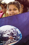 A BanglaDesh girl holds a banner with an image of the water on Earth during a children session to discuss water issues with other children of the world in the IV World Water Forum in Mexico City, March 16. 2006.  Over ten thousand representatives of 120 countries are attending the meeting to discuss water issues. Photo by Javier Rodriguez © Javier Rodriguez