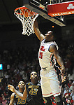 Mississippi's LaDarius White (10) dunks against Missouri's Alex Oriakhi (42) at the C.M. &quot;Tad&quot; Smith Cliseum on Saturday, January 12, 2013. (AP Photo/Oxford Eagle, Bruce Newman)