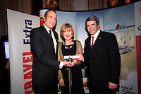 NO REPRO FEE: 27.1.12: Travel writer Isabel Conway was presented with the Travel Extra Journalist of the Year Award at a ceremony held to coincide with the annual Holiday World Show, which takes place at the RDS Simmonscourt, Dublin this weekend. Pictured was Alex Incorvaja form the Malta Tourist Board and Eoghan Corry, Editor of Travel Extra presenting the Travel Extra Journalist of the Year Award to Isabel Conway (centred) from The Irish Examiner. Picture Collins Photos.