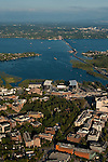Aerial view of the new Husky stadium with floating bridge and Lake Washington and Bellevue skyline