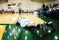 14 February 2008: Vermont's Mike Trimboli (#13) lays on the floor after missing what would have been the wining shot at the end of the game in which Vermont lost to Boston 59-58 in men's basketball action at Patrick Gym in Burlington, Vermont.