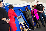 Congresswoman Anna Eshoo, left, joins Karen Meredith for the unveiling of a plaque that will designate the Mountain View Post Office as the Lt. Kenneth M. Ballard Memorial Post Office.<br />