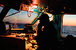 The skipper of a fishing boat speaks on the radio.