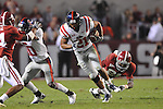 Ole Miss wide receiver Lionel Breaux (21) is chased by Alabama defensive back Dre Kirkpatrick (21) at Bryant-Denny Stadium in Tuscaloosa, Ala.  on Saturday, October 16, 2010. Alabama won 23-10.