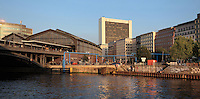 Friedrichstrasse Bahnhof, a mainline and underground train station in Berlin, seen from the Schiffbauerdamm on the bank of the river Spree, Berlin, Germany. Picture by Manuel Cohen