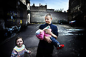 Warsaw 23.04.2008 Poland<br /> Warsaw disrict North Praga calls the most dangerous place in Polish capitol by city dweller _ on picture _ young boy feed her sister on the street<br /> (Photo by Adam Lach / Napo Images for Newsweek Polska)<br /> <br /> Warszawska dzielnica Praga Polnoc uznawana za najbardziej niebezpieczna przez mieszkancow stolicy<br /> (Fot Adam Lach / Napo Images dla Newsweek Polska)