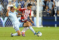 Chivas Guadalajara midfielder Marco Fabian (8) holds off the challenge of Davy Arnaud Sporting KC... Sporting Kansas City and Chivas Guadalajara played to a 2-2 tie in an international friendly at LIVESTRONG Sporting Park, Kansas City, Kansas.