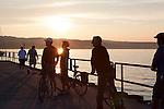 Tourists and locals bike in Open Space Park, Lake Michigan, Traverse City, Michigan, MI, USA